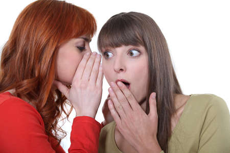 Woman whispering to her friend Stock Photo - 15574228