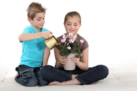 Children watering flowers photo