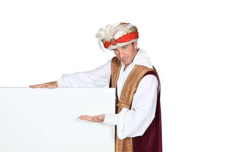 Man in Sultan Fancy Dress Costume with blank board Stock Photo - 15573358