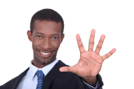 outstretched: Studio shot of a businessman with the palm of his hand outstretched in front of him Stock Photo