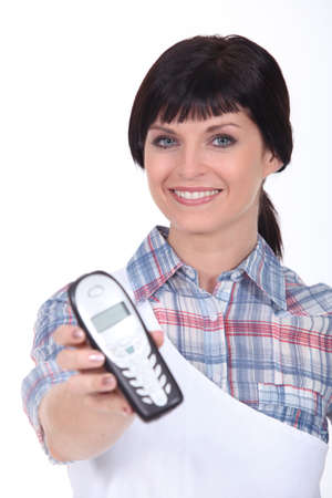 brunette with blue eyes and cordless phone