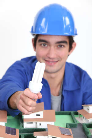 Tradesman holding a fluorescent lamp photo