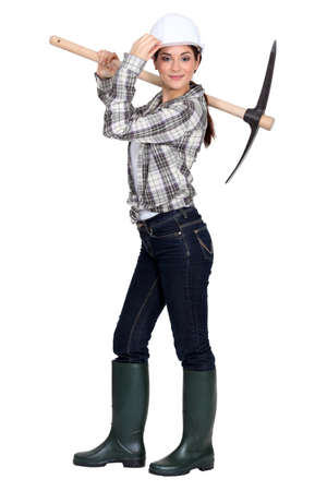 alluring brunette holding pickaxe photo