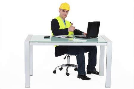 upright: Architect sitting with computer Stock Photo