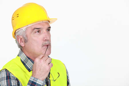 Pensive construction worker Stock Photo - 15573991