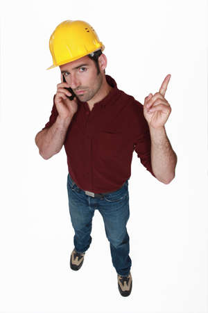 Stern foreman wagging his finger Stock Photo - 15573427