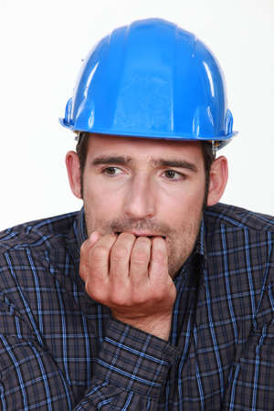 Nervous man wearing a hardhat photo