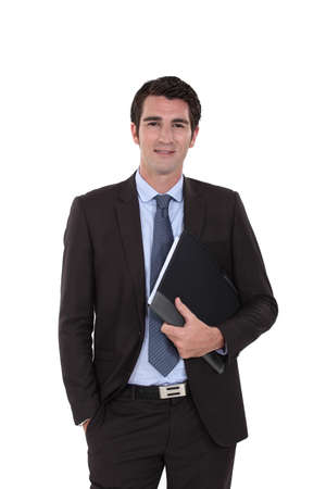 A businessman standing with his folder. Stock Photo - 15573621