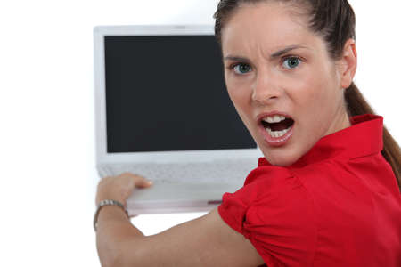 Woman angry with her laptop photo