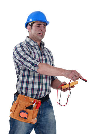dumb: Electrician with a voltmeter