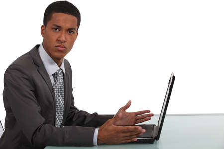 confused man: Businessman frustrated by laptop