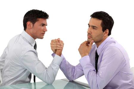 hankering: handsome businessmen arm wrestling