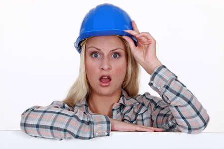 confound: craftswoman looking very surprised Stock Photo