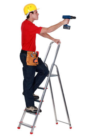 A handyman with a drill. photo