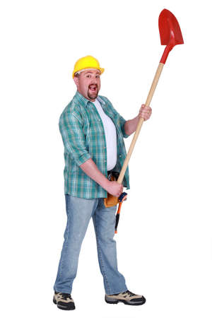Happy man holding shovel Stock Photo - 15579267