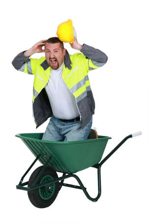 barrow: Builder screaming whilst knelt in wheelbarrow