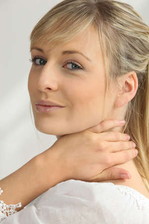 verve: Blonde woman with hand on neck