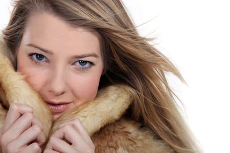 Woman wearing fur coat photo