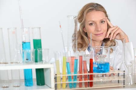erlenmeyer: blonde female biologist posing in lab Stock Photo