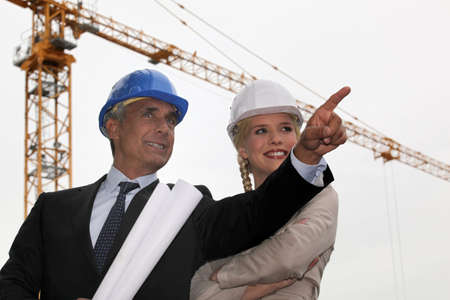 erecting: Architect and assistant happy with progress