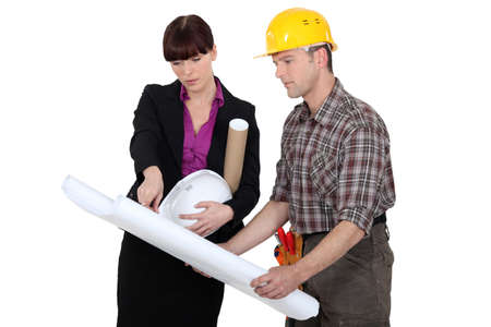 conferring: Tradesman consulting with an engineer Stock Photo