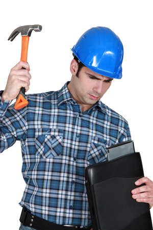 hard drive: Tradesman hitting his laptop