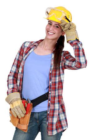 non verbal: Smiling tradeswoman