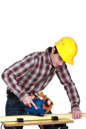 craftsman working on a wooden board Stock Photo - 15627495