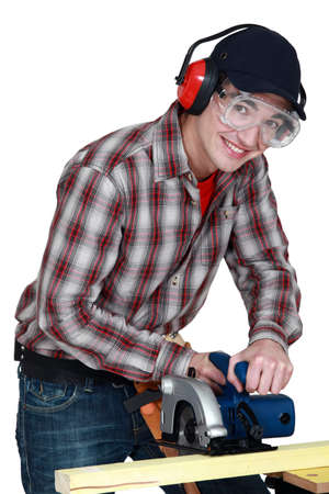 Man using a circular saw photo