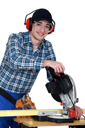 industrialized: Tradesman using a circular saw