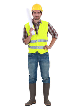 reflective background: Engineer in a reflective vest with plans