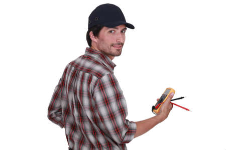 Electrician making safety checks photo