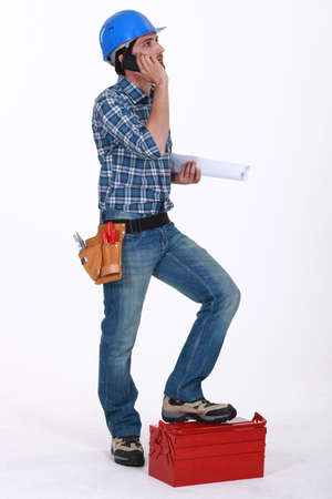 Builder with tool box making call Stock Photo - 15626689