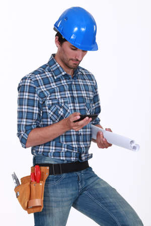 white color worker: Construction worker checking his phone Stock Photo