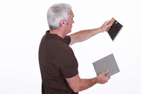 affix: craftsman holding a tile and a tool