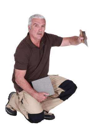 senior tiler working Stock Photo - 15627831