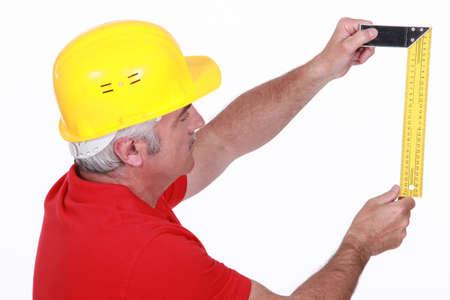 wood cutter: craftsman taking measurements