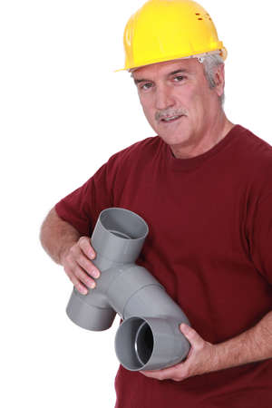 60 65 years: A plumber holding parts Stock Photo