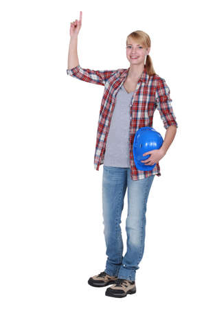 chemise: female carpenter pointing upwards
