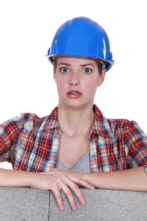 alarmed: Alarmed female construction worker