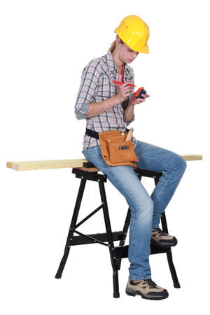 supported: Artisan sitting on bench Stock Photo