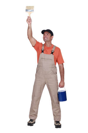 Happy tradesman painting a wall Stock Photo - 15610199