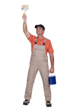 Happy tradesman painting a wall Stock Photo - 15610199