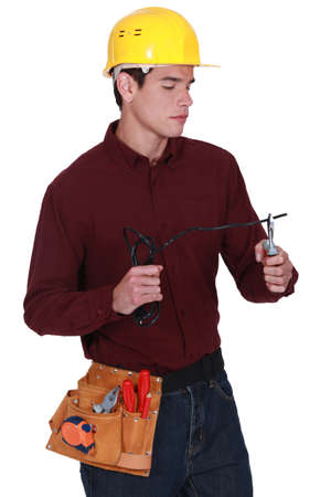 wirecutters: Electrician snipping electrical cable Stock Photo
