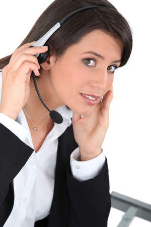 telephonist: Young woman wearing a headset