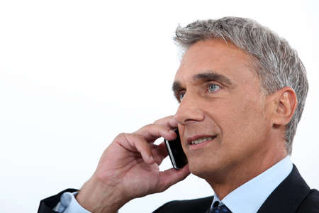 old cell phone: Mature businessman using a cellphone Stock Photo