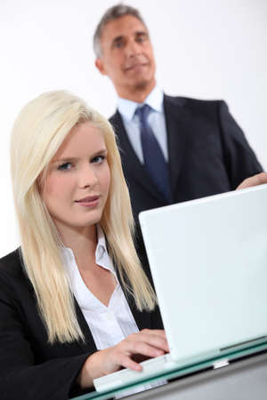 platinum hair: Man approaching blond woman Stock Photo