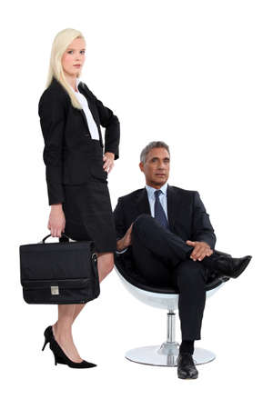 Studio shot of a smart business duo Stock Photo - 15610428