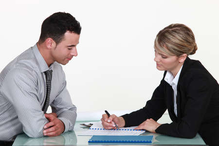 legal office: Woman explaining contract to man