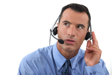 fidgety: Man speaking into a hands-free headset Stock Photo